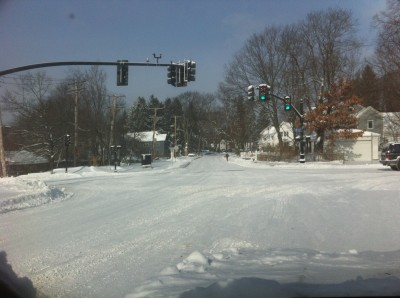 the intersection of South Road and Railroad Ave, with snow covering the pavement