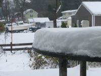 snow piled on the table on the back porch