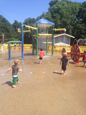 Zion, Lijah, and Julen running in the sprinkler park