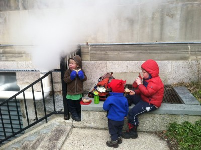 the boys having a picnic by a steam vent outside the Arlington library