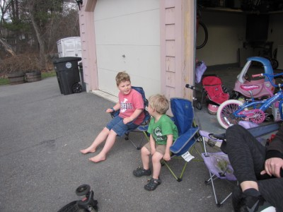 Harvey and Zion in their camping chairs in the neighbors driveway