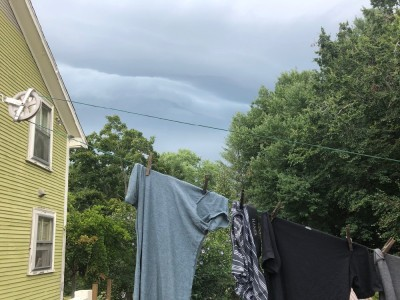 storm clouds behind the laundry on the line