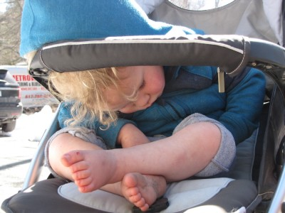 Lijah sleeping leaning forward in the stroller