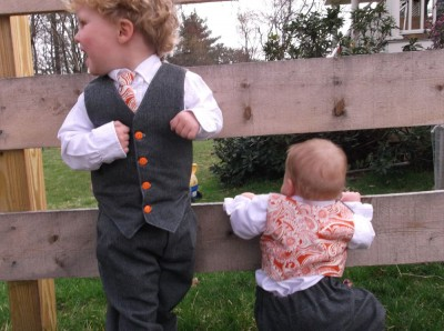 kids playing by fence in easter suits