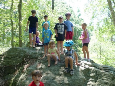 kids posing atop a rock
