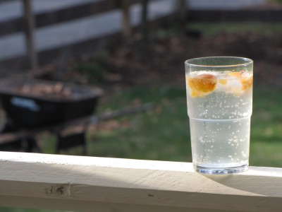 fizzy water with orange lime in the porch sun