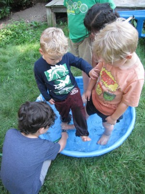 Lijah in the wading pool with long pants