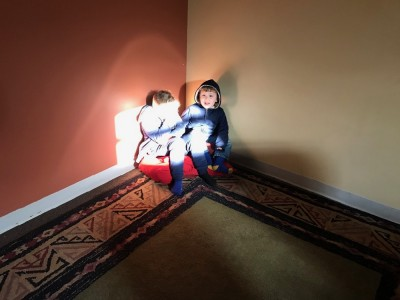 Zion and Lijah in a sunbeam at church