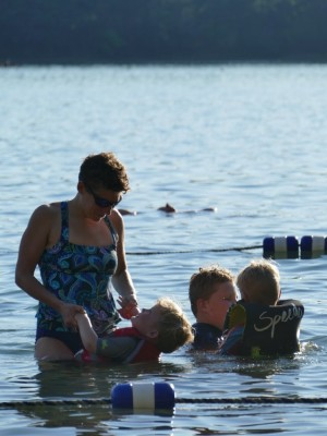 Mama playing with the boys in the water