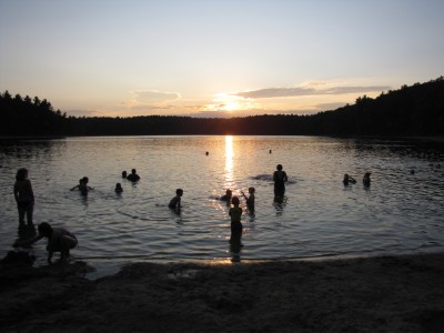 swimming in Walden Pond at sunset