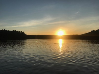 the sun setting over Walden Pond