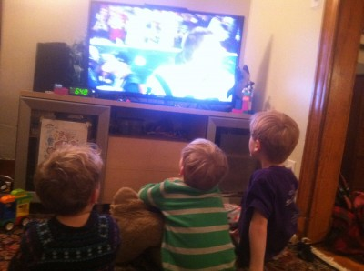 Lijah, Zion, and Nathan watching the Superbowl on tv