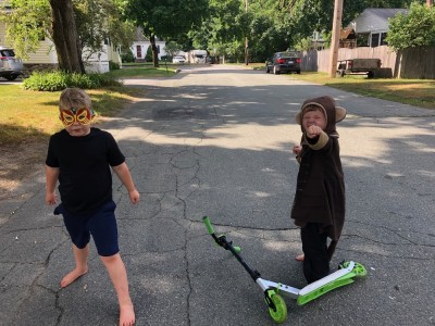 Zion in a mask, Lijah in a monkey suit, giving battle poses