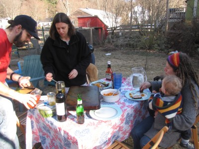 the table outside with food, tablecloth, Luke, Bridget, Mama, and Lijah