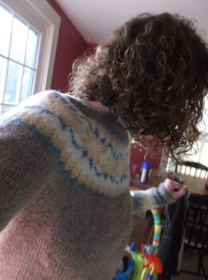 mama dancing in the kitchen in new sweater