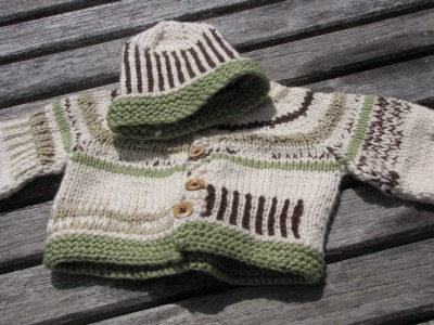 white, green, and brown sweater and matching hat