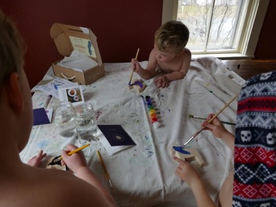 the kids painting at the table