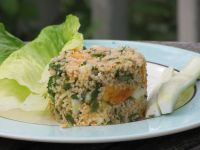 tablouleh, made with orange tomatoes, on a plate
