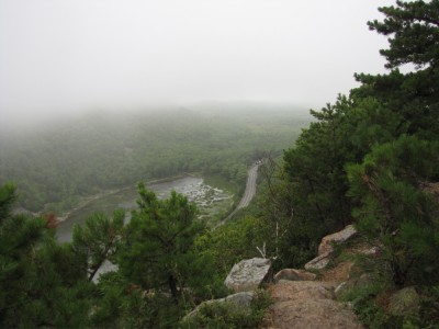 a view of The Tarn through the fog from the lower slopes of Champlain