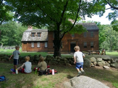 the boys eating lunch in front of Hartwell Tavern