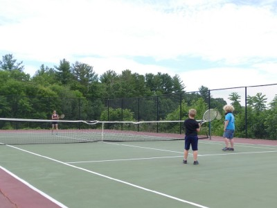 Leah playing tennis with Harvey and Zion