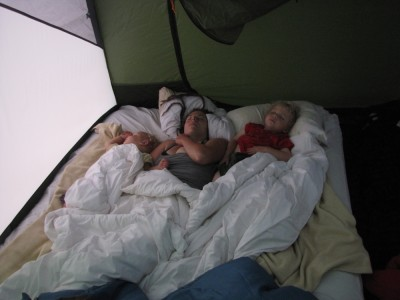 Lijah, Mama, and Zion sleeping on the air mattress in the tent