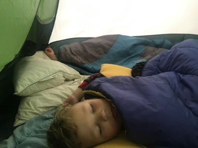 Zion and Lijah sleeping in the tent