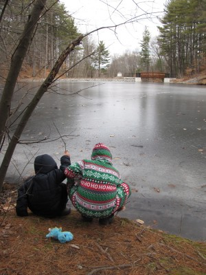 the boys testing the ice on the pond