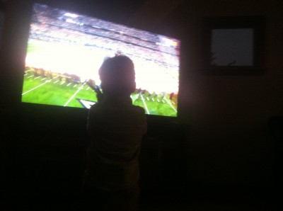 Lijah watching an enormous television