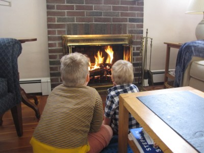 Harvey and Zion sitting in front of Grandpa's fire