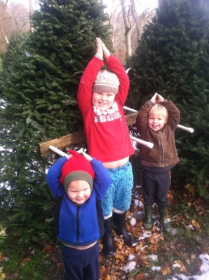 three boys pretending to be Christmas trees