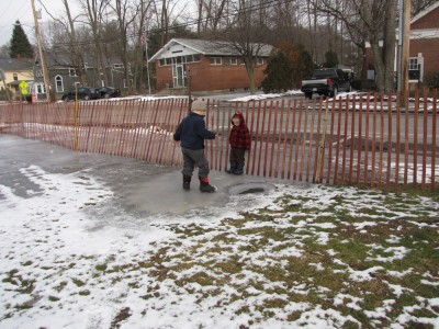 Harvey and Zion sliding on the overflow off to the side of the rink