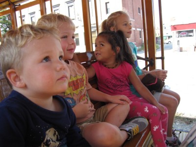 the kids riding the real trolley