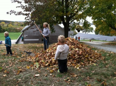 Lijah watching the big kids make a leaf pile