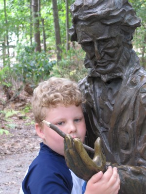 Harvey with the Thoreau statue, the pencil in Henry's hand
