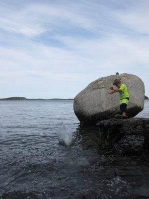 Harvey throwing a big rock into the ocean, making a big splash