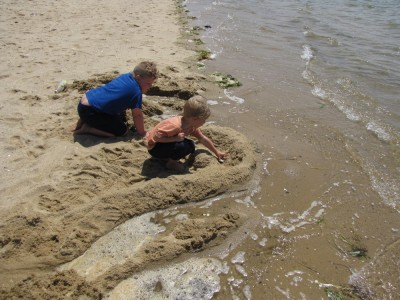 Harvey and Zion working on a sandcastle