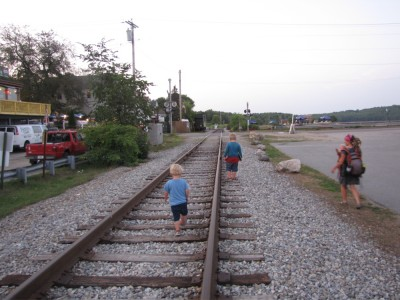 Mama and the boys walking along the train tracks