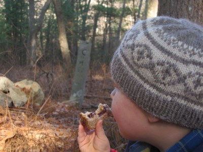Harvey eating a sandwich in the woods