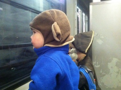 Lijah and Zion looking out the window of the subway