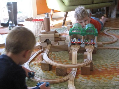 Lijah and Harvey building a train track