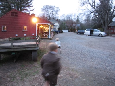 Harvey and Zion running towards the farm store in the dusk