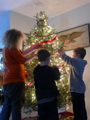 the boys decorating the Christmas tree