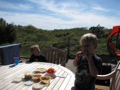 Zion and Lijah eating appetizers at the deck table