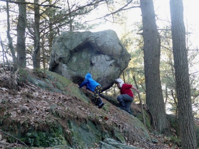 Harvey and Zion climbing up to a giant erratic boulder