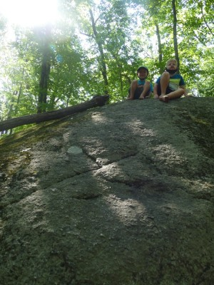 Zion and Elijah atop a big rock