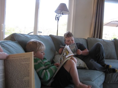 Zion and Harvey reading on the couch