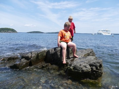 Harvey and Zion on a wave-beset rock in Bar Harbor