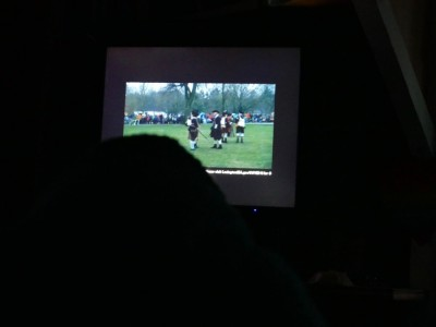 Lijah watching the minuteman on a screen in a dark room