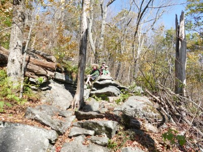the boys resting on a rock on the way up Mt Wachusett